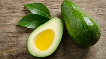 Fresh Avocado And Half Of Avocado Like A Bowl For Oil On Wooden