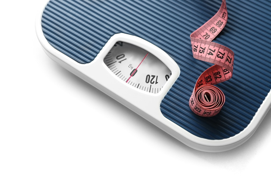 Bathroom scale with measuring tape on white background. Weight l