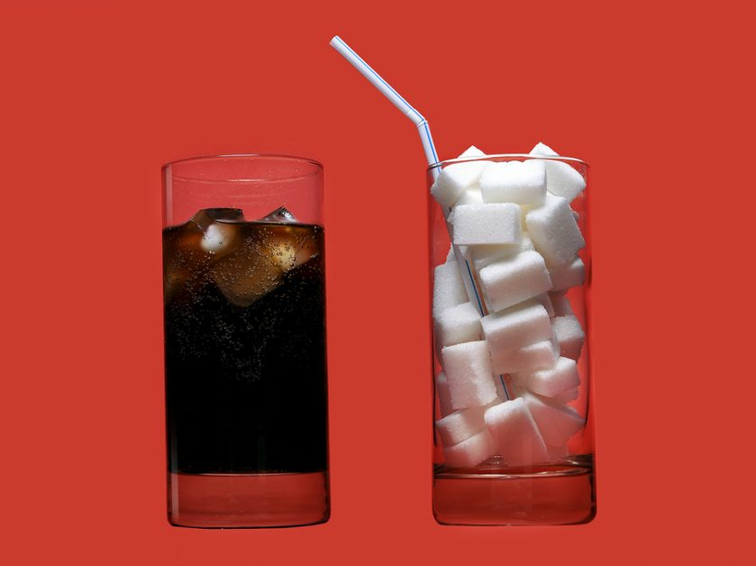 Cola Refreshing Drink And Glass Full Of Sugar Cubes And Straw Re