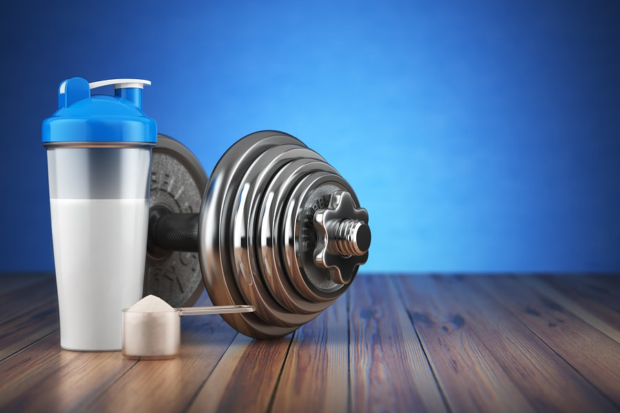 Dumbbell and whey protein shaker. Sports bodybuilding supplement